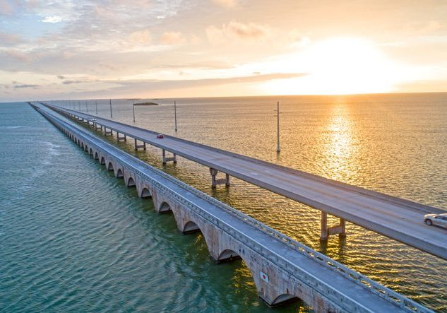 Overseas Highway Seven Mile Bridge Traffic at Sunrise. View From Florida Keys Tropical Road to Paradise